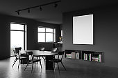 Grey dining room corner with poster