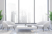 White office waiting room with armchairs