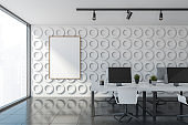 White open space office interior with poster