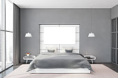 Gray and white bedroom with horizontal poster