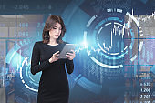 Businesswoman with tablet, HUD financial interface