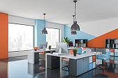 Blue and orange open space office corner