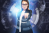 Woman in glasses using HUD business interface