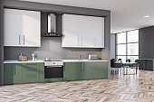 Gray and green kitchen corner, counters and table