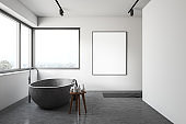 White bathroom with stone tub and poster