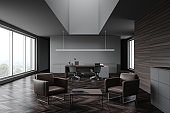 Gray and wood CEO office with lounge
