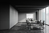 Loft grey open space office interior with poster