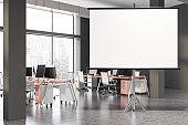 Mock up screen in gray open space office