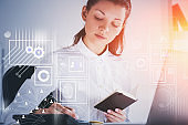 Businesswoman with notebook in office, GUI