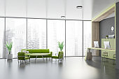 Gray office waiting room with green sofa