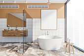 Orange bathroom with tub and poster