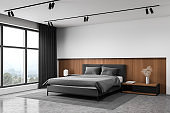 White and wooden master bedroom corner
