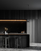 Marble and dark wood kitchen with bar