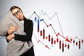 Sleeping businesswoman, falling financial chart