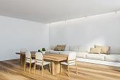 White dining room corner with sofa