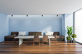 Blue dining room interior with sofa