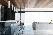Panoramic blackk living room with bar