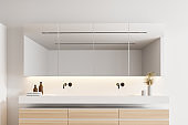 Double sink in white bathroom interior