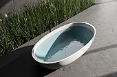 Concrete floor bathroom with tub, top view