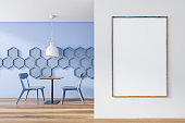 Blue cafe interior with hexagons and poster