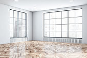 Empty white room corner with windows