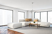 Panoramic white living room corner with sofa