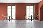 Modern orange restaurant interior with chairs