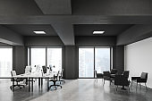 Grey and wooden open space office with lounge