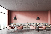 Pink coffee shop interior with sofa and armchairs