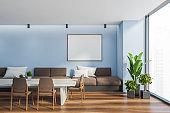 Blue dining room interior with poster