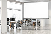 Mock up screen in white open space office