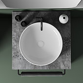 Top view of sink in white and green bathroom