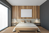 Mockup blank frame in wooden and grey bedroom with bed with linens