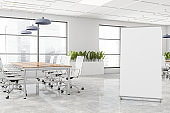 Panoramic white meeting room with banner