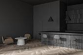 Stylish dark gray cafe bar corner with armchairs
