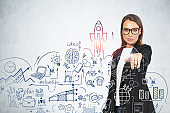 Woman in glasses choosing startup sketch