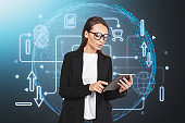 Businesswoman with tablet, cybersecurity interface