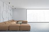 Geometric white living room, beige sofa, side view