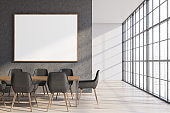 Concrete and white dining room with poster