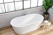 Cozy tub in white tile bathroom, top view