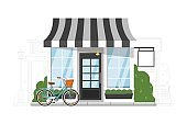 Small fastfood restaurant on cityscape silhouette