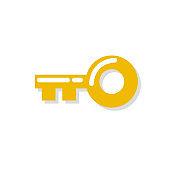 Gold key icon. Vector illustration in flat design