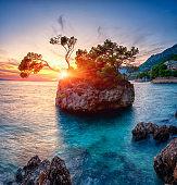 Amazing sunset seascape, scenic view of Brela stone, a symbol of Adriatic resort. Travel background, Croatia
