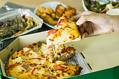 Eat at home by ordering through the delivery service,Selective focus Delicious pizza,Spaghetti BBQ Chicken Wings and a salad next to it