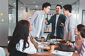 An argument arose between two men during the meeting with the boss resisting in group brainstorm at office.Businesspeople discussing with paperwork for business plan,Corporate of modern colleague