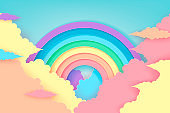 Stylized paper cutout rainbow and clouds background. Paper pastel colored rainbow. Vector art and illustration