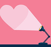 desk lamp illuminates its ray in heart shape to the wall vector illustration design with space for text
