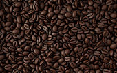 Dark freshly roasted coffee beans 3d rendering background. Top view. Masses of coffee beans close up.