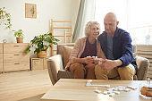 Happy Senior Couple Playing Domino