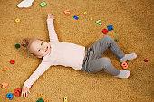 Playful Little Girl On Floor